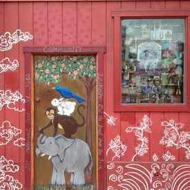 Photo of Painted Door Beside Tibetan Gift Cornet in Haight-Ashbury