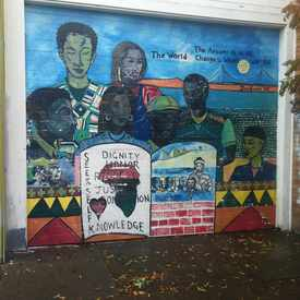 Photo of Seek Self Knowledge Mural in Longfellow