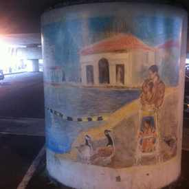 Photo of Mural Of Man Walking Child At Lake Merritt in Lakeshore