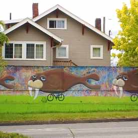 Photo of Mural of Three Walruses Riding Tiny Bicycles in Phinney Ridge